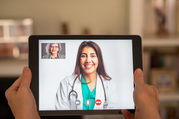 elderly-woman-having-video-call-consultation-with-doctor-tablet_127069-838