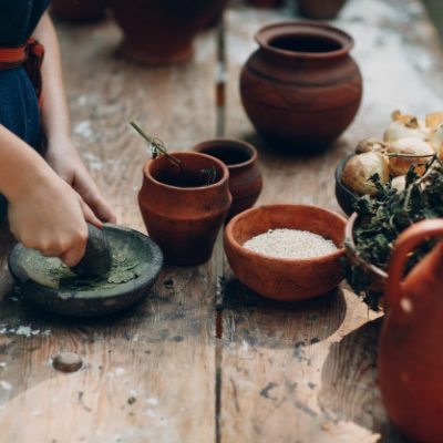 woman-grinds-grass-with-pestle-mortar_183314-224