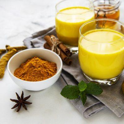 yellow-turmeric-latte-drink-golden-milk-with-cinnamon-turmeric-ginger-honey-white-marble-background_87742-15693